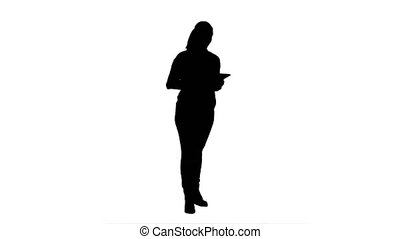 Silhouette Young woman using reading presentation from a tablet.