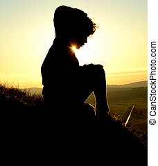 Silhouetted Child At The Top Of A Hill At Sunset