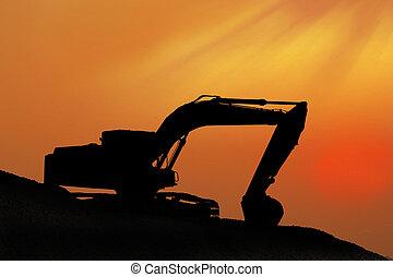 Silhouetted Digging Machine