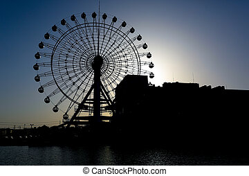 Silhouetted giant wheel in Shimizu, Japan