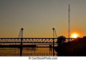 Silhouetted Nebraska and South Dakota two tiered bridge