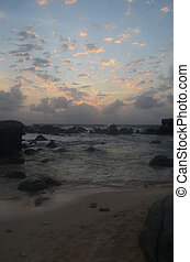 Silhouetted Rocks with Colorful Skies Over the Ocean in Aruba