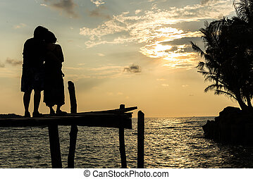 Silhouettes at sunset on the beach
