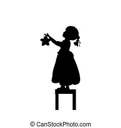 Silhouettes child stands on stools holds christmas star.