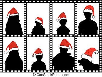 Silhouettes family in santa caps.