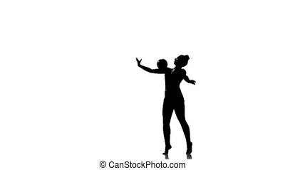Silhouettes Gymnast plays with a ball, nice trick, white background. slow motion
