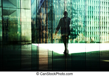 silhouettes of woman walking in the business district of Paris, La Defense