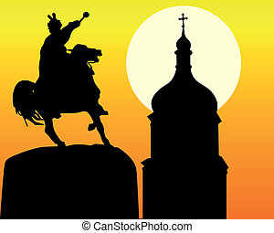 silhouettes Khmelnytsky monument and tower of the church in Kiev on an orange background