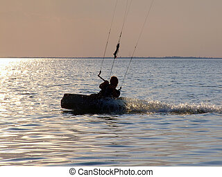 Silhouettes kitesurf on a gulf on a sunset 2