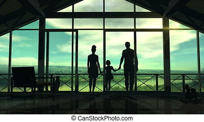 Silhouettes of a happy family on the veranda