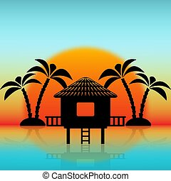 Silhouettes of bungalow and palm trees against rising sun....