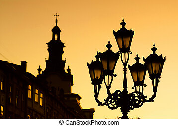 silhouettes of city lantern on the sunset