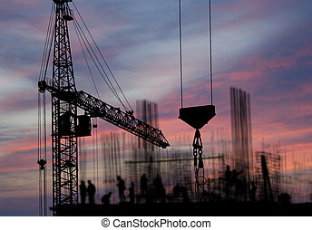 silhouettes of construction workers, construction equipment ...