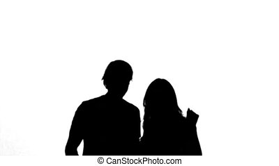 Silhouettes of couple raising their