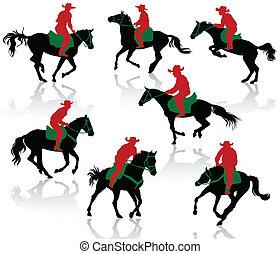 Silhouettes of cowboys on horseback