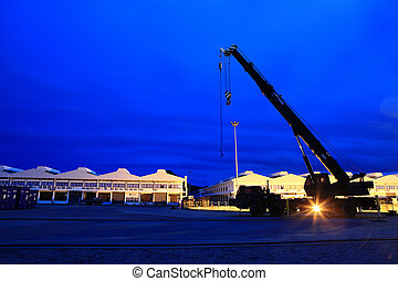 Silhouettes of  crane truck