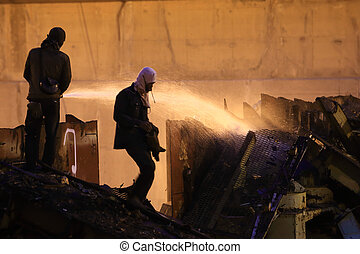 Silhouettes of  firemen before a fire