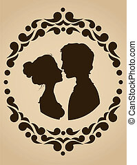 Silhouettes of kissing couple in an ornate frame