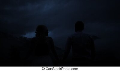 Silhouettes of kissing couple in the twilight