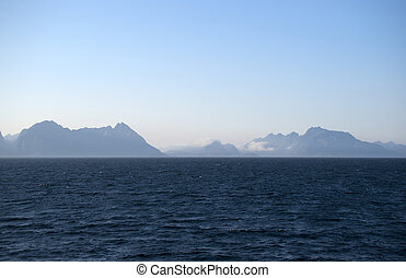 Silhouettes of Lofoten islands in the fog, Norway