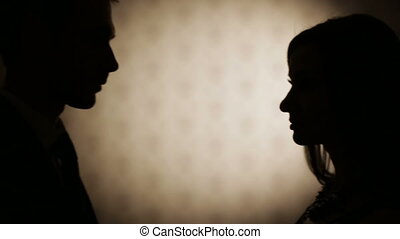 Silhouettes of man and woman - Silhouettes of a loving...