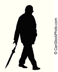 Silhouettes of man walking  with an umbrella