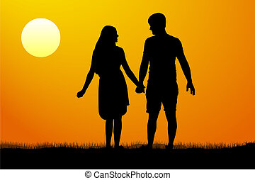 Silhouettes of men and women standing and holding hands at...