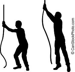 Silhouettes of men pulling ropes