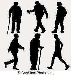 silhouettes of men walking