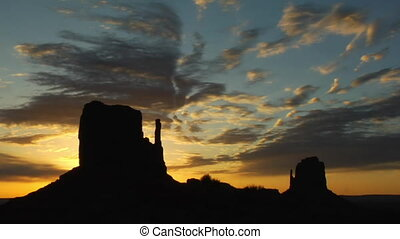 silhouettes of monuments Monument Valley at sunset