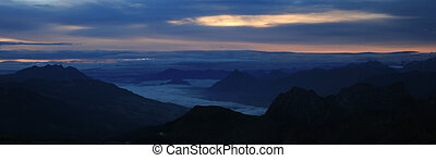 Silhouettes of Mount Pilatus, Rigi and Stanserhorn.