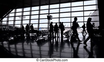 Silhouettes of people in modern hall
