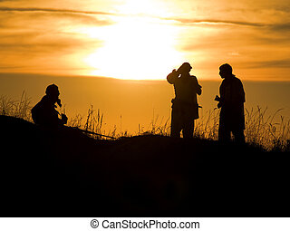 soldiers - Silhouettes of several soldiers with rifles ...