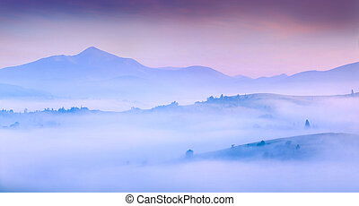 Silhouettes of the mountains in the morning mist.