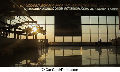 Silhouettes of travelers at the airport