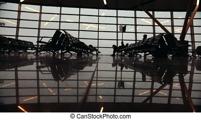 Silhouettes of travelers in Airport International Terminal. Feet close up