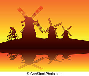 silhouettes of windmills and the rider on an orange background