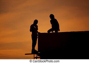Silhouettes of worker welder