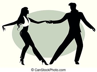 Silhouettes of young couple dancing