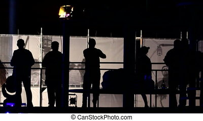 Silhouettes on the platform