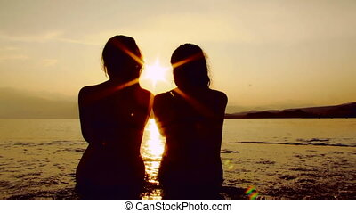 Silhouettes on the shore