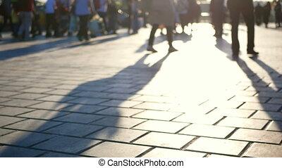 Silhouettes people walking