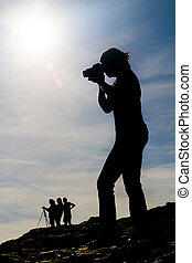 silhouettes taking photos - View of some people in ...
