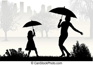 Silhouettes under the umbrella.
