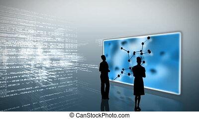Silhouettes watching molecular clips on grey data digital...