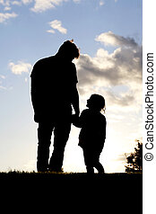 Silhoutte Of Loving Moment Between Father and Young Child