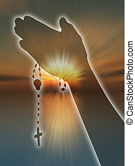 Silhoutte of praying hands against sunset