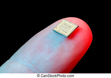 Silicon microchip on fingertip - Silicon micro chip on human...
