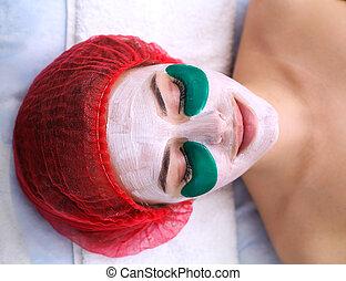 Green moisturizing mask under the eyes.