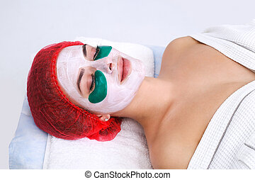 Green moisturizing mask under the eyes.